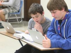 Students work on Apple MacBook Air laptop computers.