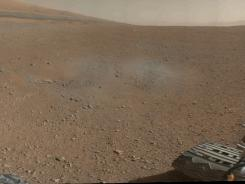 A color image from NASA's Curiosity Rover shows the pebble-covered surface of Mars.