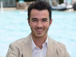 Kevin Jonas: Pop star will know if you're ringing his doorbell when he's across the country.