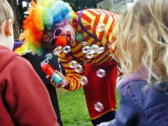 "In this 2006 file photo, ""Kenny the Clown"" entertains during the Fairfax Farmer's Market in Marin County, Calif."