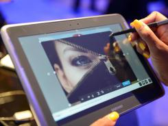 A woman experiments with the Samsung Galaxy Note in New York.