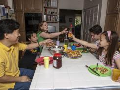 David Oh, a flight director of NASA's latest Mars mission, and his family have breakfast at 3 pm at their home in La Canada Flintridge, Calif.