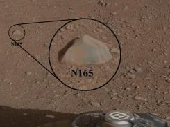 This image shows a close-up view of a Martian rock that the NASA rover Curiosity zapped using its laser on Sunday.