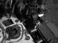 This image released by NASA shows tracks made by Curiosity's tires during its first test drive.