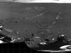 This 360-degree panorama provided by NASA on Aug. 22 shows evidence of a successful first test drive for NASA's Curiosity rover.