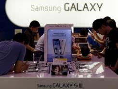Visitors shop around Samsung's smartphones Saturday at a mall in Seoul, South Korea.