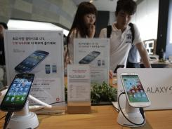 Samsung Electronics' Galaxy S III phones are displayed Monday at a store in Seoul.
