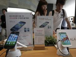 Samsung's Galaxy S III phones are displayed at a mobile phone shop in Seoul.