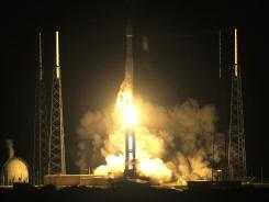 An Atlas V rocket lifts off from Cape Canaveral Air Force on Thursday carrying the twin Radiation Belt Storm Probes.