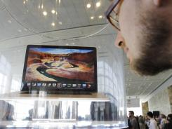 An attendee looks at the new MacBook Pro on display at the Apple Developers Conference in San Francisco in June.