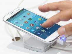 A visitor tries out a Samsung Galaxy S III smartphone at the Samsung stand at the IFA 2012 consumer electronics trade fair in Berlin, Germany.