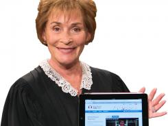 Judge Judy, with her iPad.