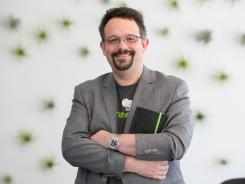 CEO Phil Libin. The new notebook has special paper that can be scanned by a smartphone or tablet camera and made searchable in the app.