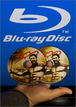 A Best Buy salesman shows copies of Warner Bros' film 300 in both Blu-ray Disc and HD DVD in Burbank, Calif. in Feb. NPD Group said Blu-ray sales haven't been helped by HD DVD's demise.