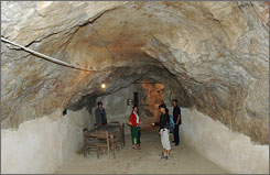 People tour the Keysone Phomvihane's cave in Viengxay, Houaphanh province, Laos. The country has opened up to tourism a complex of caves which once sheltered communist guerrilla leaders from the most intense bombing campaign ever unleashed by the United States.