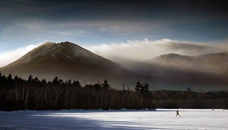 In Maine: Mile-high Mount Katahdin overlooks Katahdin Lake in Baxter State Park, an all-seasons retreat for vacationers.