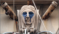 Getting a facelift: A sculpted head on the facade of the dilapidated Book Cadillac Hotel awaits renovation.