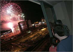 Hotel guests watch fireworks seconds before the implosion of the Stardust hotel-casino in Las Vegas on Tuesday. The property, which opened on July 2, 1958, was imploded to pave the way for Boyd Gaming Corp.'s $4.4 billion megaresort complex, Echelon Place.