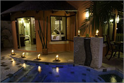 For couples only: Relax in the romantic pool at the Sandals' Rondoval Suites, St. Lucia.