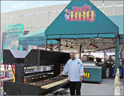 In Philadelphia: Sous chef Grant Yarbrough cooks up ribs and wings on the new grill at Bull's BBQ at Citizens Bank Park.