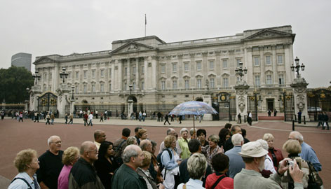 Looking is free: Visitors gather outside Buckingham Palace, one of the Queen's official residences, in London.