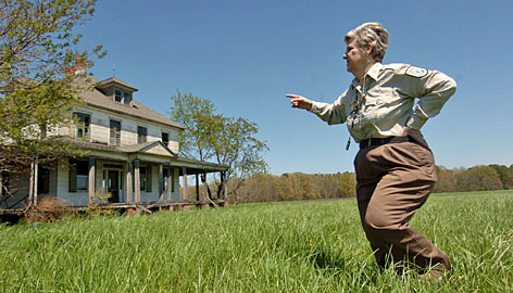 Maggie Briggs, visitor services manager for the Blackwater National Wildlife Refuge, points to a circa 1913 farmhouse near the refuge that the state of Maryland has acquired for a potential Harriet Tubman museum