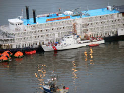 Passengers from the cruise ship Empress of the North are offloaded onto the Coast Guard Cutter Liberty and civilian vessels after  running aground off the coast of Alaska.