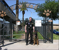 Man's best friend: Officer Jason Toth stands with his dog Zassko at the Phoenix Sky Harbor International Airport dog park.