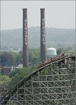 Hersheypark at 100: The Hershey Chocolate factory looms behind the Wildcat roller coaster.