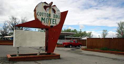 The Cotton Boll Motel's sign in Canute, Okla., is among the most-photographed along Route 66. The motel's owner, Pat Webb, checked into the 16-room building in the late 1990s and never left, turning a part of the place into his personal residence.