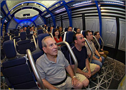"Buckle up: After everyone's strapped in, the 44-seat simulator chambers tilt back as the ride starts, then begin shake as the shuttle ""launches."""
