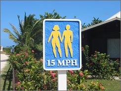 In St. Martin: A road sign warns drivers to go slow at clothing-optional resort Club Orient, which fronts Orient Bay, a nude beach.