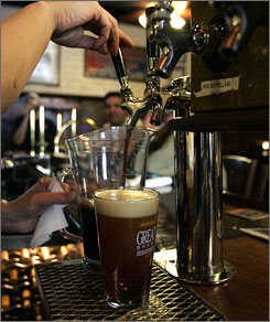 Good pour: A bartender pulls a pitcher of one of the many brews on tap at the Great Lakes Brewing Company in Cleveland, Ohio.