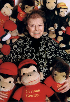At home: Curious George co-creator relaxes with the famous monkey.