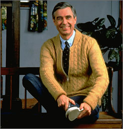 In this 1996 publicity photo, Fred Rogers poses on the Pittsburgh set of his television show  Mister Rogers' Neighborhood. An exhibition about Mister Rogers is opening at a children's museum in New Orleans later this month.