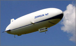 A Zeppelin NT blimp flying over Germany. Plans are aloft for Zeppelin NT07 airship tours in the U.S. beginning in 2008.