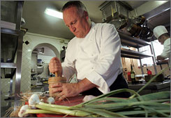 Italian chef Antonello Colonna crushes freshly picked garlic in his estate in Labico, on the outskirts south of Rome.
