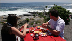By the sea:Lori and Jay Kaplan of Denver, Colo., find a beachfront picnic table to be the perfect setting for their lobster meal.