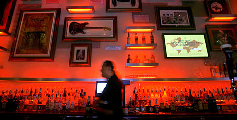 The chain's trademark musical memorabilia hangs above a bar at the Hard Rock Biloxi, reopening this week almost two years after Hurricane Katrina crashed its original grand opening.