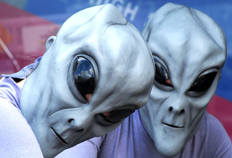 Festival-goers pose in alien garb during Roswell, N.M.'s annual UFO convention. As the site of an alleged spacecraft crash landing in 1947, Roswell continues to draw space travel enthusiasts and conspiracy theorists.
