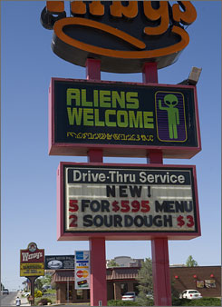 Businesses in Roswell acknowledge the UFO conventioneers in many amusing ways.