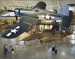 IAD: A World War II Vought F4U-1D Corsair is suspended over the Lockheed SR-71A Blackbird at the Smithsonian's Udvar-Hazy Center near Dulles.