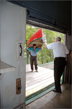 A canoeist loads his canoe aboard the Adirondack Scenic Railroad train after paddling downstream.