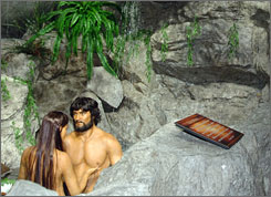 An Adam and Eve display is one of several Old Testament  exhibits at the Creation Museum in Petersburg, Ky.