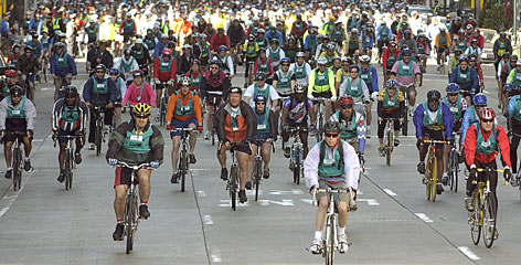 Riders converge on Sixth Ave. in Manhattan during the annual 5 Boro Bike Tour, a 42-mile ride through New York for which the city closes several major roads to all but bicycle traffic.