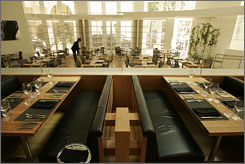 """""""Exceeded expectations"""": Custom-designed furniture and place settings decorate the dining room at Wolfgang Puck's steakhouse."""