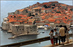 Spectacular views: Tourists look over Dubrovnik and the Adriatic Sea. Visitors from Europe and the USA are once again flocking to the city.