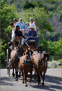 Eric Bartels, front left, of Mancos, Colo., leads a family on a stagecoach ride through the Morefield Campground at Mesa Verde National Park. The park made a Fordor's guide as one of the best national parks for cultural history.