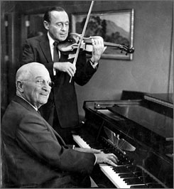 Former President Truman in 1959, playing the piano with Jack Benny on violin, during the time Benny filmed his tv show at the Truman Library.