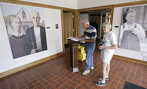 John and Dorothy Greenfield, of Centerville, Ohio, sign the guest book during a stop at the American Gothic House visitors center.
